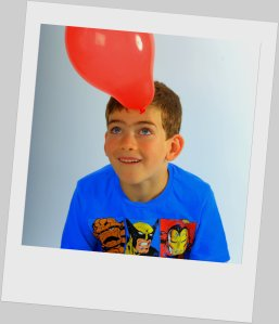 Young Boy having fun, party, balloon